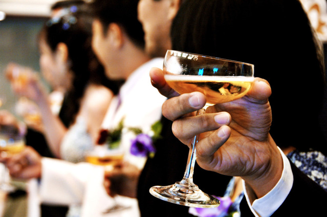 a glass full of champagne during a wedding day feast