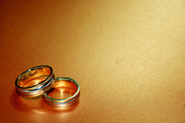 wedding rings on a smooth wooden table